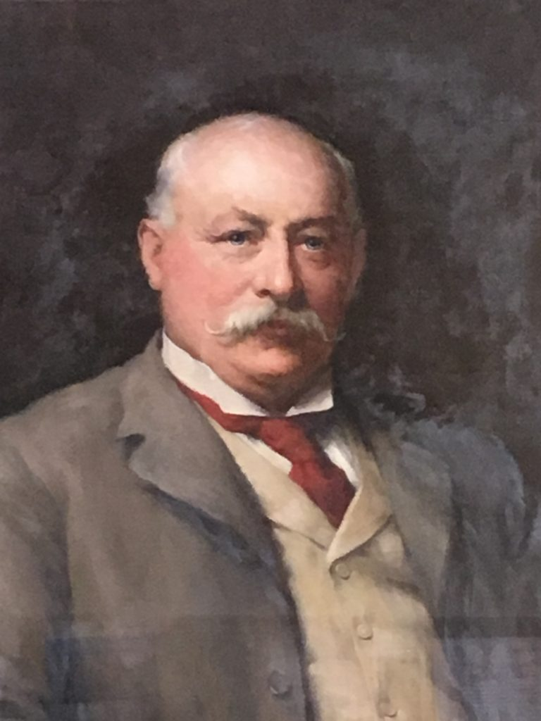 """Portrait of Harry Simpson Gee, with a plaque saying """"Presented by the Shareholders of the Leicestershire Banking Company Ltd to Harry Simpson Gee Esq in recognition of his long services as Director and Chairman."""