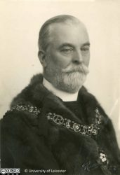 Black and white photograph of Sir Jonathan North, 1922. North is wearing his chain and gown of office. Taken for the programme of the Grand Bazaar and Fete of 1922.