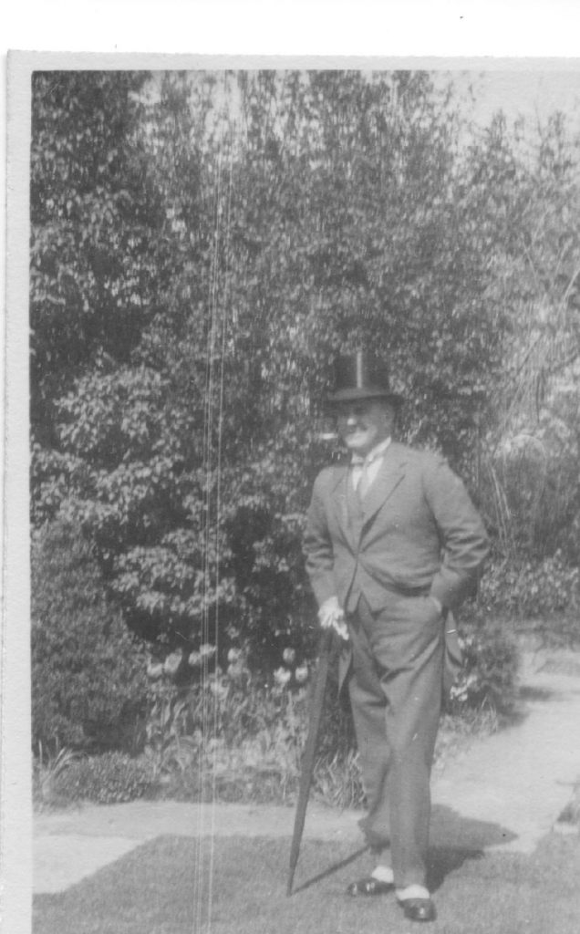 Black and white photograph of Dr Astley Clarke wearing a top hat.