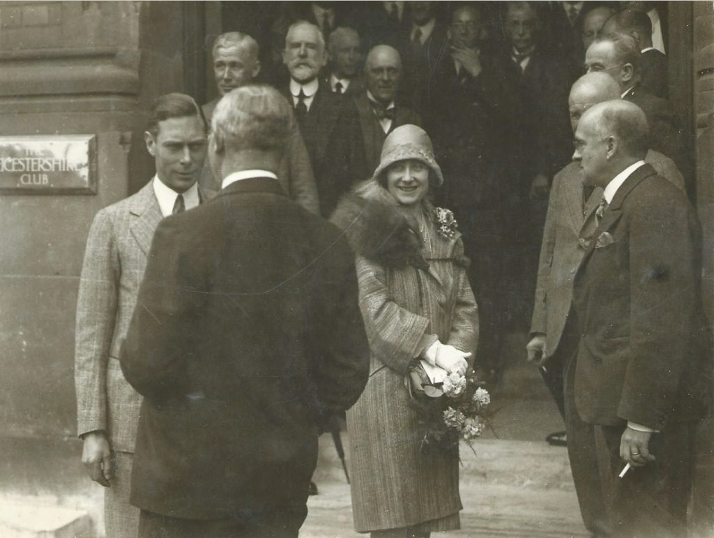 Photograph of Sydney Tyler (at right) meeting the Duke and Duchess of York, outside the Leicestershire Club.