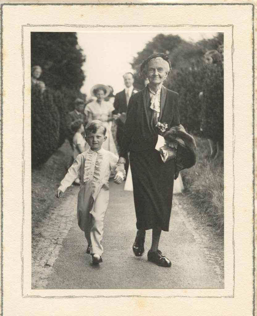 Black and white photograph of Ethel (Poppy) Clarke, with young boy.