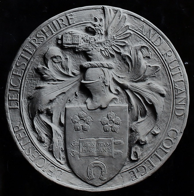 Photograph, from Dr Astley Clarke's scrapbook, of the original College seal, sculpted by Joseph Herbert Morcom from the local Art School.