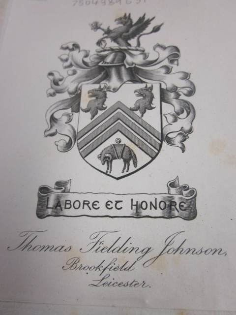 Photograph of Thomas Fielding Johnson's book plate showing his coat-of-arms