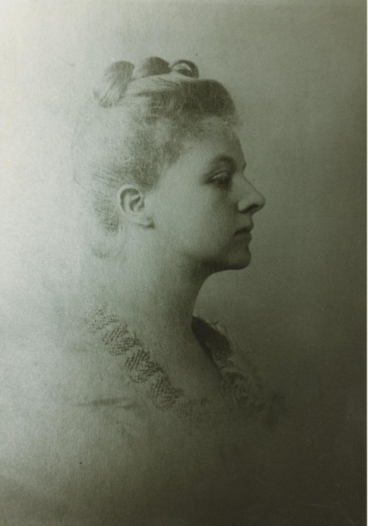 Black and white profile photograph of Isabel Ellis.