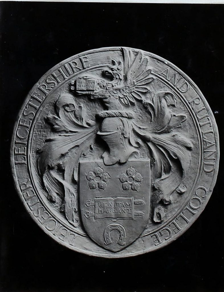 Black and white photograph of the coat of arms of Leicester, Leicestershire and Rutland College