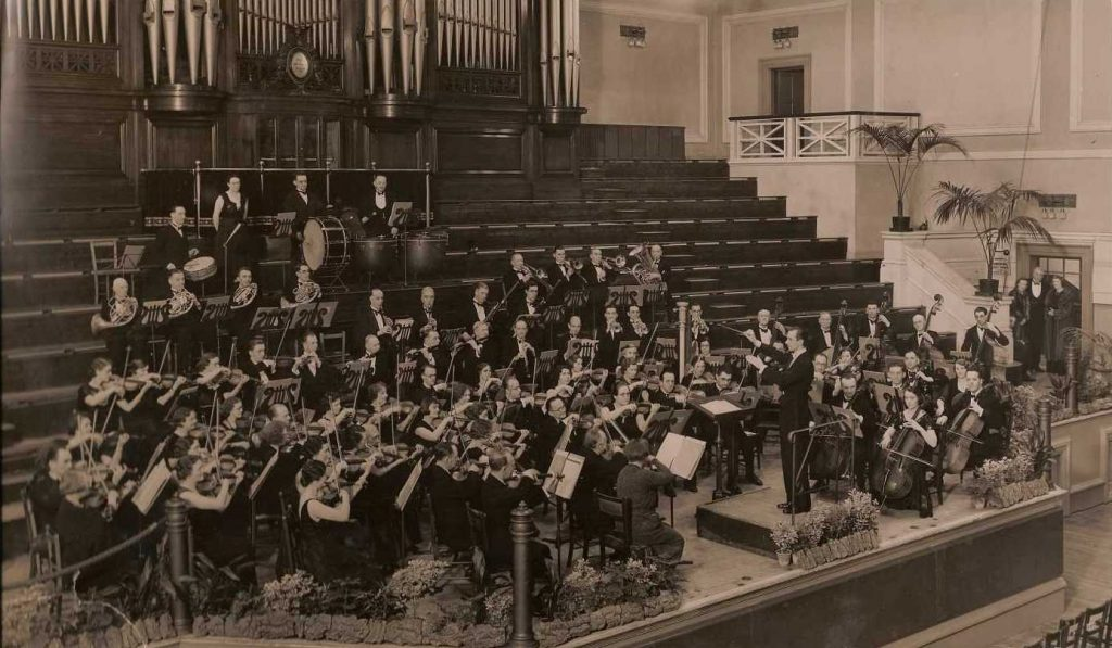 Black and white photograph of Malcolm Sargent conducting the Leicester Symphony Orchestra, courtesy Leicester Symphony Orchestra.
