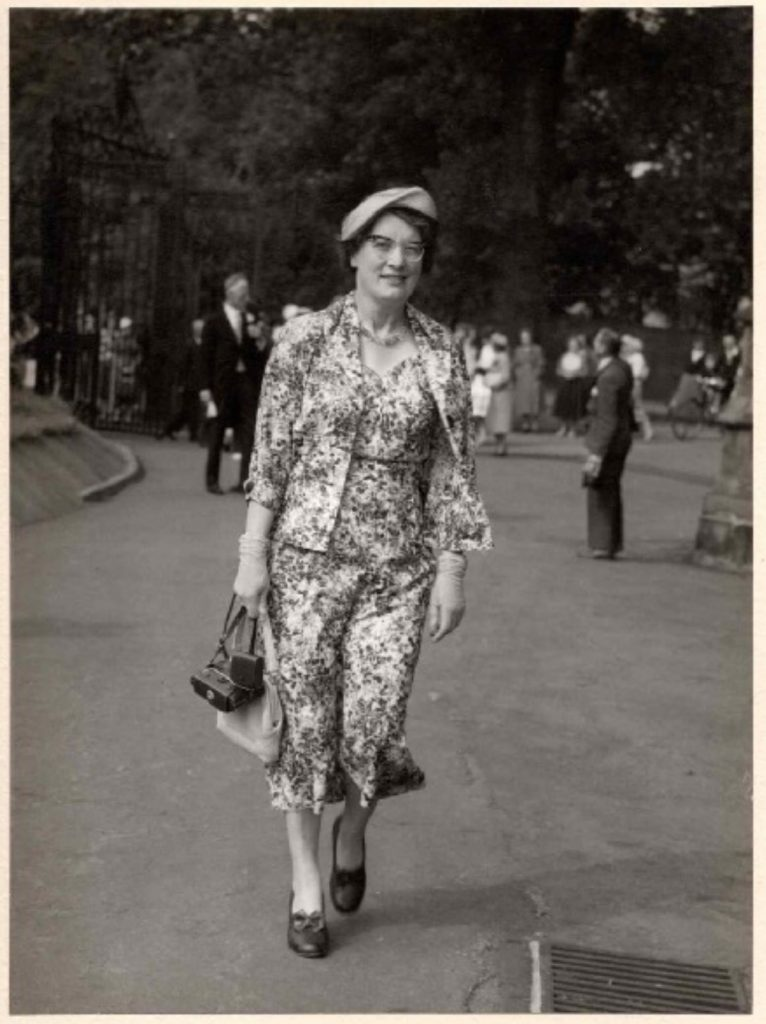 Black and white photograph of Mabel Towle attending a family wedding, 1958