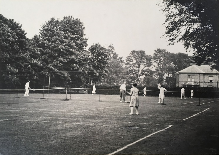 Black and white photograph of students using the University College tennis courts, near College House, c.1929, a photograph in the University of Leicester Archives, ULA/FG1/3/12