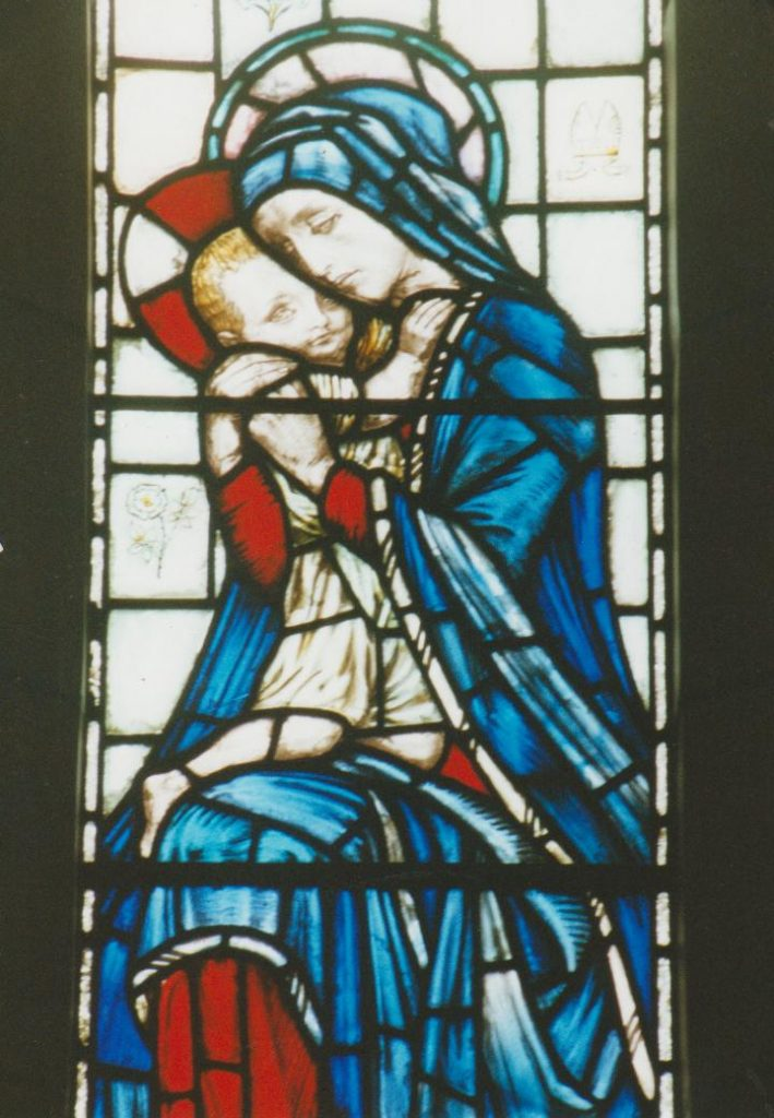 Photograph of stained glass window in St James the Greater church in memory of Augustine Gee